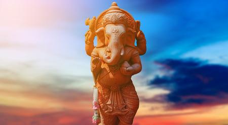 Genesha elephant god with sunset sky background