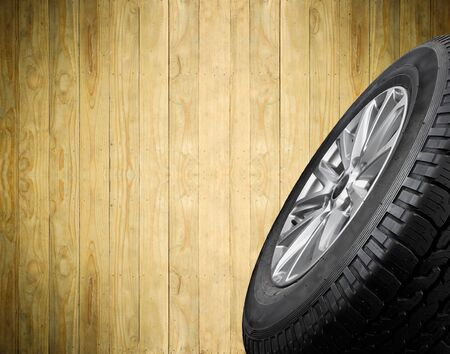 traction: Close up tyre with wooden background space use for text display