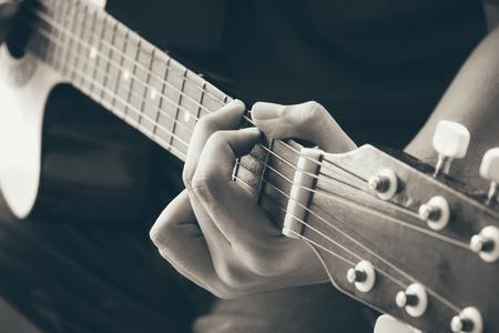 Close up human hand show playing guitar