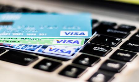 BANGKOK, THAILAND - JULY 21, 2017: closeup shot of credit card issued by VISA on computer keyboard