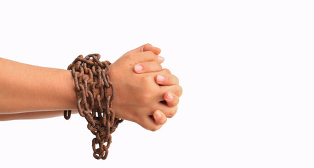 cuff link: Mans hands tied with chains isolated on white background