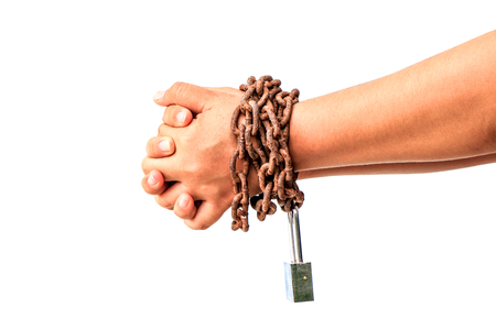 Mans hands tied with chains isolated over white background