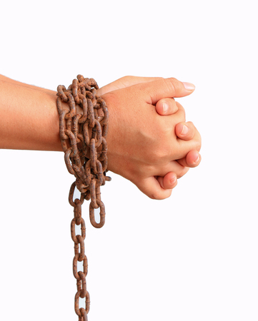 Mans hands tied with chains isolated on white background