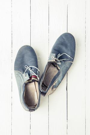 Blue old men shoes put on wooden tabletop background