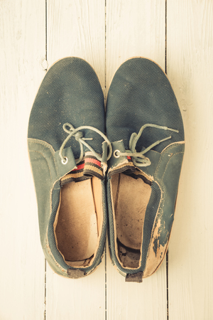 leather texture: Blue old men shoes put on wooden tabletop background