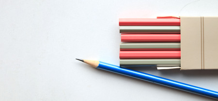 Close up blue pencil with color on white background