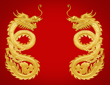 Close up golden wooden craft dragon isolated on red background Stockfoto