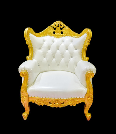Close up vintage luxury golden chair isolated Stock Photo