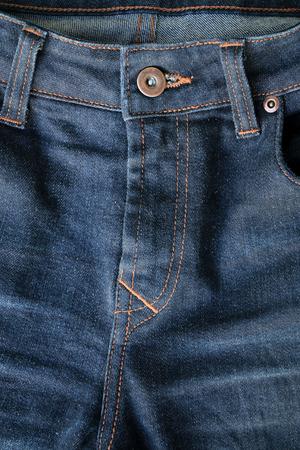 Close up blue textile denim jeans texture background