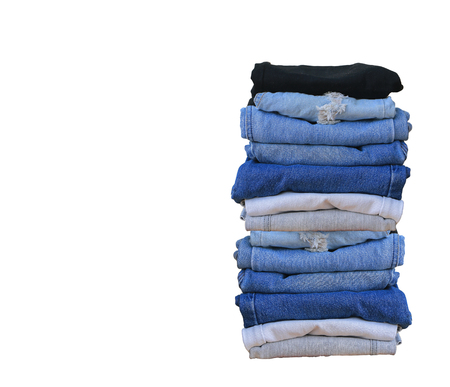 Stack of blue jeans on black background with copy space Stock Photo