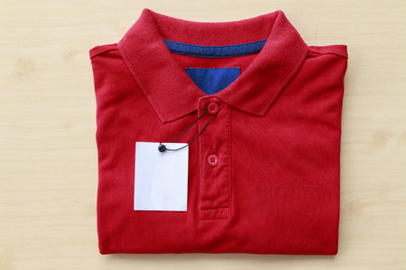 Close up polo shirt put on wooden tabletop