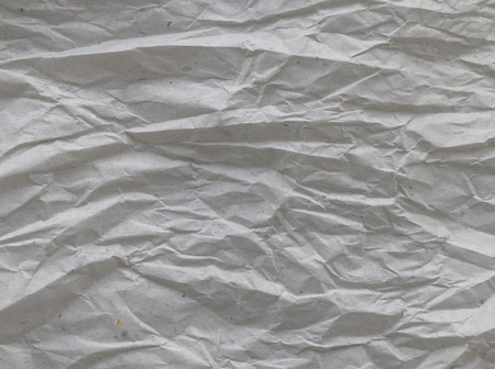 Crumpled paper texture and crushed grunge paper background