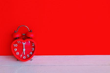 Close up red alarm clock mark at 6 oclock in the morning