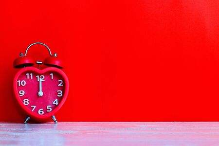 Red alarm clock mark at 12 o'clock with space background