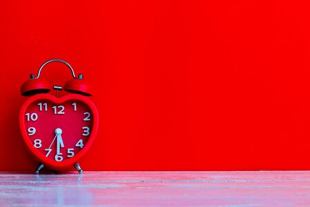 Close up red alarm clock mark at 5.30 with space background