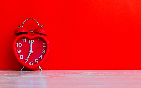 red alarm clock mark at 7.00 in the morning