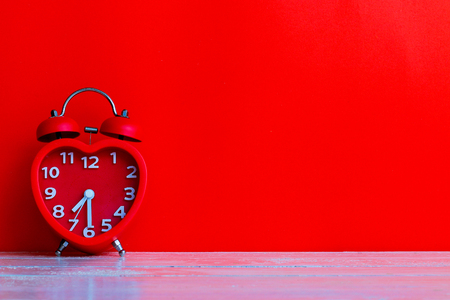 red alarm clock mark at 7.30 with red background Imagens