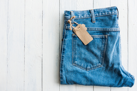 Close up denim jeans trouser put on white wooden table