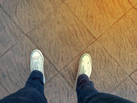 foots stand on blank floor background Reklamní fotografie