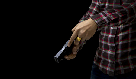 Close up male hand holding gun for shooting Stock Photo