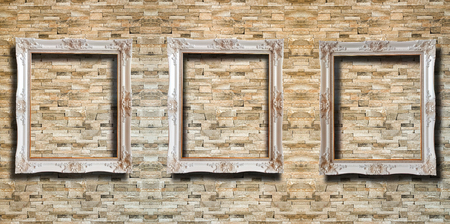 Close up wooden picture frame on red rustic brick wall background