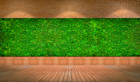 Red brick wall with fresh green grass background with space use for texts or products background