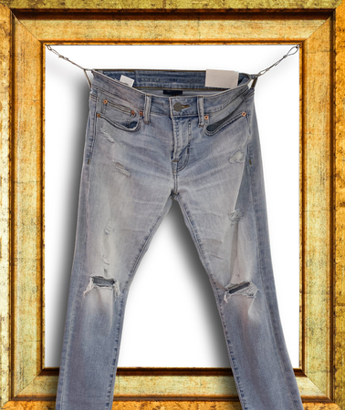 Picture of old rustick denim jeans on wooden frame background Reklamní fotografie