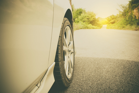 Close up car tire with road way to adventure to the country Reklamní fotografie