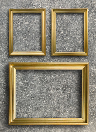Close up luxury vintage golden picture frame on rust cement wall background Reklamní fotografie