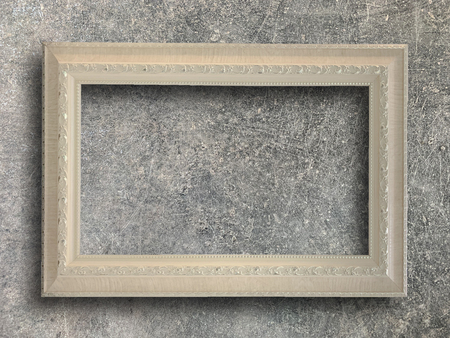 Close up old rustic picture frame on cement wall texture background