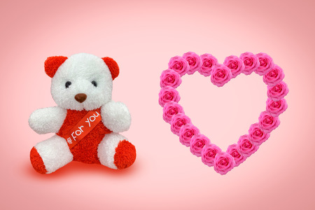 Bear doll sitting with pink background, Valentines day concept. Reklamní fotografie
