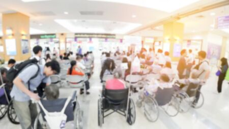 Blurred image of identified people waiting for doctor at the hospital Stock Photo