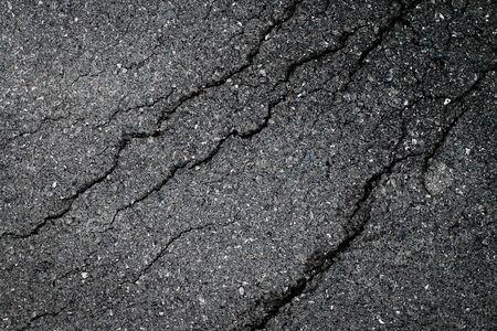Close up dark asphalt crack by earthquake texture background Reklamní fotografie - 132134527