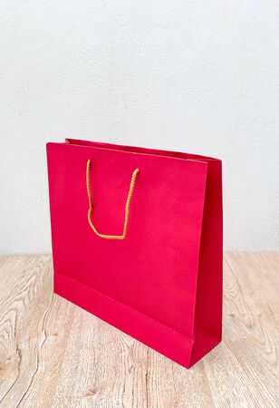 Close up red paper bag isolated on white background