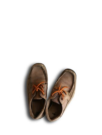 Close up rustic old brown leather shoe isolated on white background Reklamní fotografie - 132133868