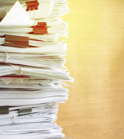 Close up stack of many documents put on wooden table