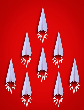 Close up top view of paper airplane group on red background Standard-Bild