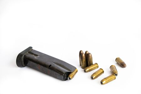 Close up gun magazine and bullets isolated on white background