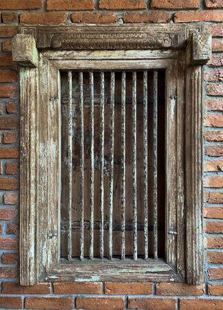 Close up grunge rustic prison window with rust brick background Standard-Bild