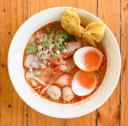 Close up top view of noodle with egg put on wooden table top Stock fotó