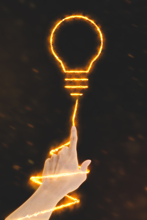 human energy: Power of Idea - Human Hand with lightbulb energy Stock Photo