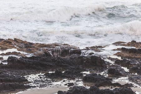 sink drain: Waves crashing on the shore at sunset. Thors Well, Cape Perpetua, Oregon, USA. Stock Photo