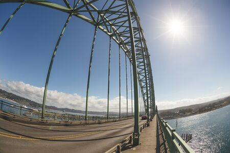 Yaquina Bay Bridge in Newport, Oregon, USA. Sunny summer day on the Pacific Ocean at the famous bridge commonly called Newport Bridge.