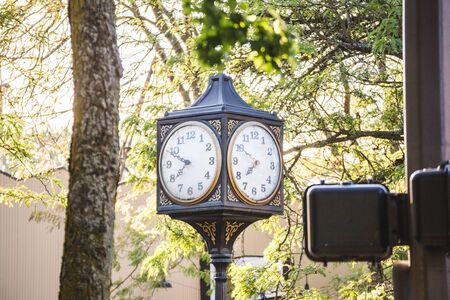 Clocks in a downtown city area in St. Johns, Portland, Oregon, USA.