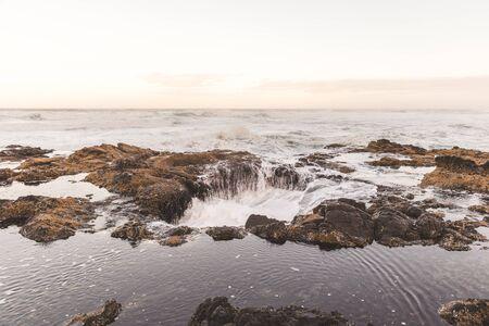 Ocean beach waves at Thors Well in Cape Perpetua, Oregon Coast, USA.