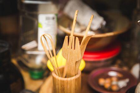 utensilios de cocina: Wooden fork, mixer, and other utinsels in a home kitchen. Foto de archivo