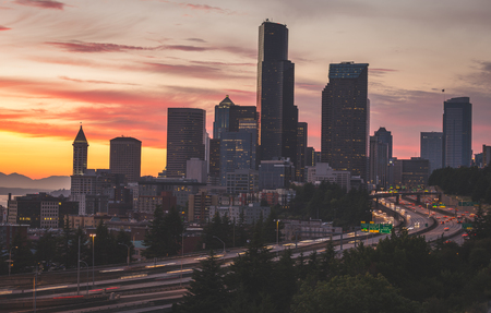 Downtown Seattle, WA and freeway with a colorful sunset shot.