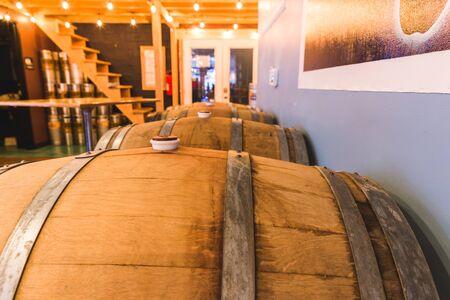 Wooden barrels or casks inside a brewpub, tap house, or restaurant.