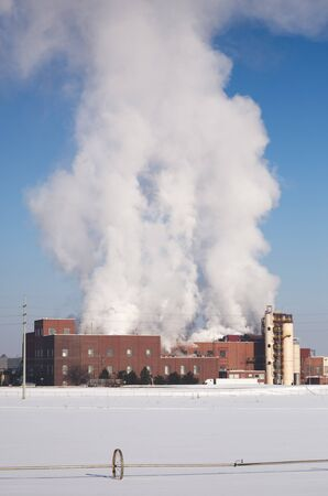 Water vapor, steam, or exhaust rising from a potato processing plant in Idaho, USA.