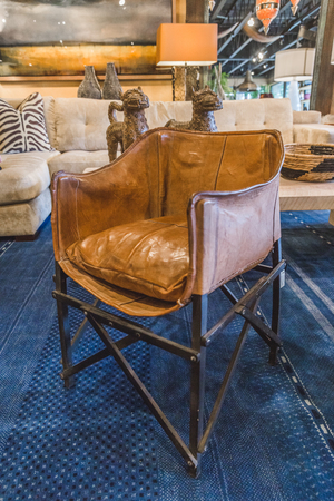 upscale: Upscale leather chair inside a furniture showroom. Stock Photo